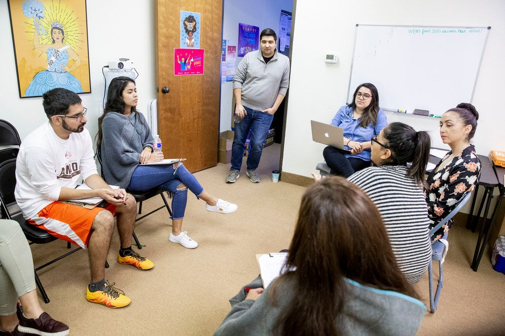David Sanchez, civics engagement director at Jolt, center, stands and listens during a Jolt workshop to help its canvassers find employment in Garland on Thursday, Nov. 9, 2018.