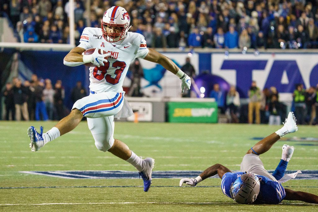 FILE - SMU tight end Kylen Granson (83) gets past Memphis defensive back T.J. Carter (2) on a 16-yard touchdown during the first half of a game at Liberty Bowl Memorial Stadium on Saturday, Nov. 2, 2019, in Memphis.