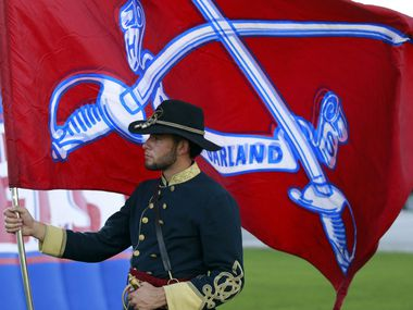 South Garland High Colonel Gabriel Valderrama, 17, then a senior, is pictured in this 2015 file photo holding the school's flag before the start of a football game.