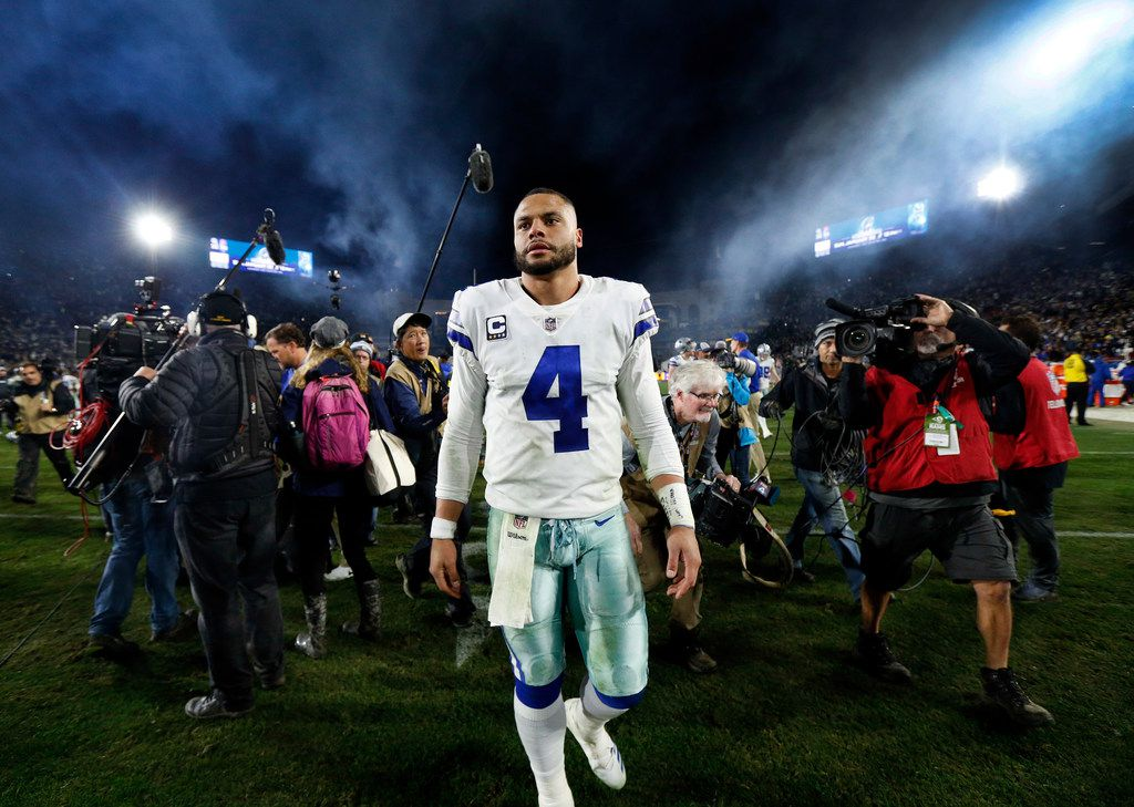 Quarterback Dak Prescott walked to the locker room after the Cowboys lost to the Los Angeles Rams in their NFC Divisional Playoff game at Los Angeles Memorial Coliseum on Jan. 12.