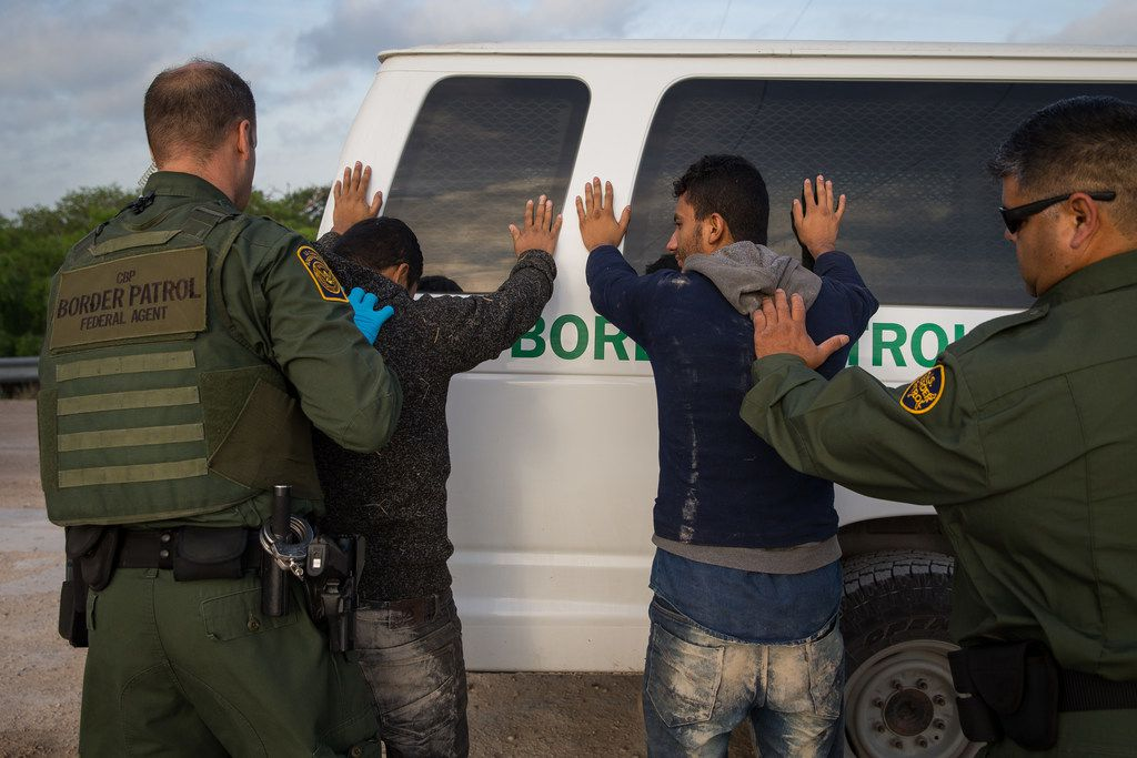 Border Patrol agents apprehend immigrants shortly after they crossed the border from Mexico into the United States on Monday, March 26, 2018 in the Rio Grande Valley Sector near McAllen.
