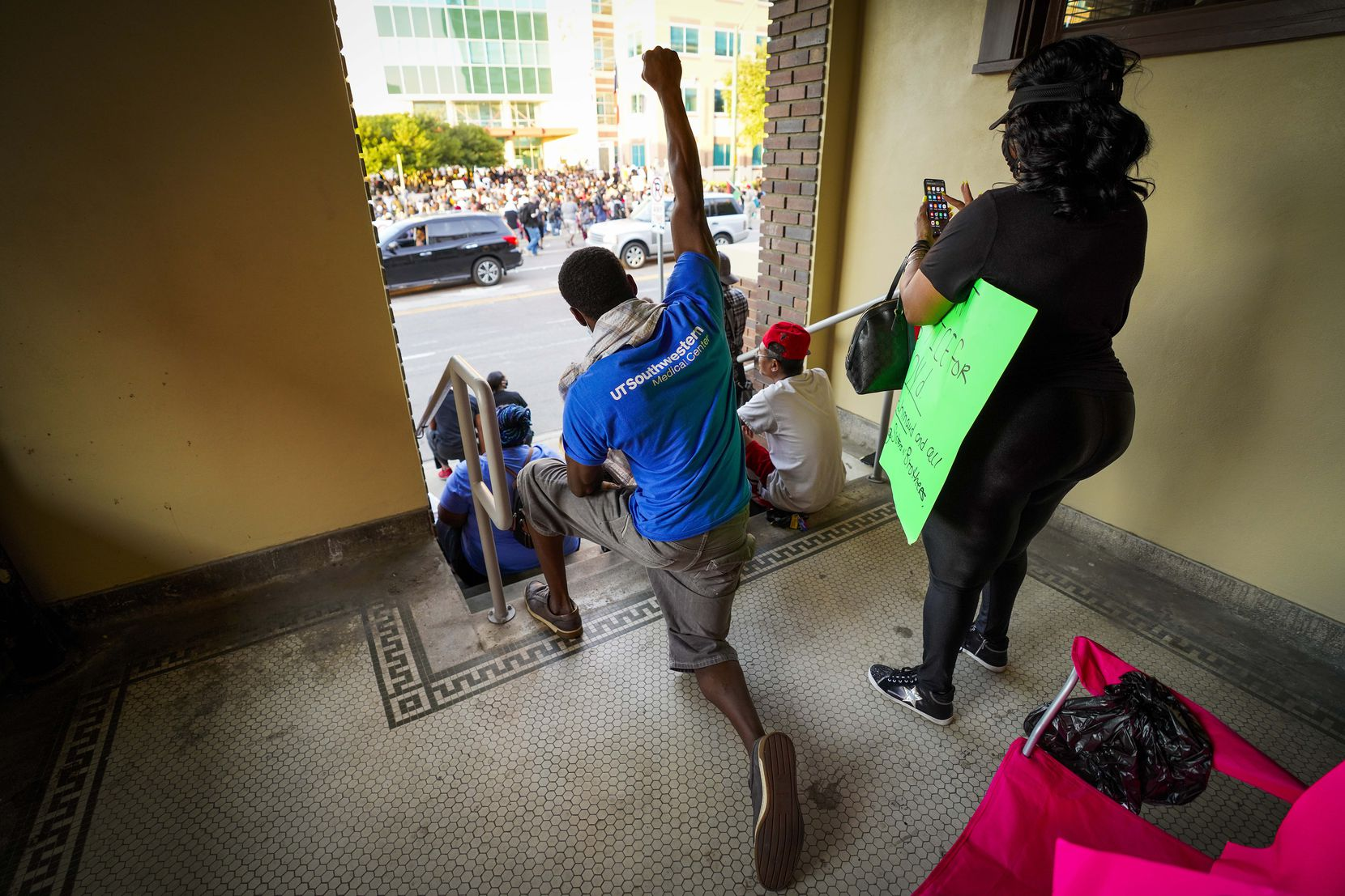 Jamal Joyner takes a knee in honor of George Floyd during a protest against police brutality at the Dallas Police Headquarters on Friday, May 29, 2020, in Dallas.