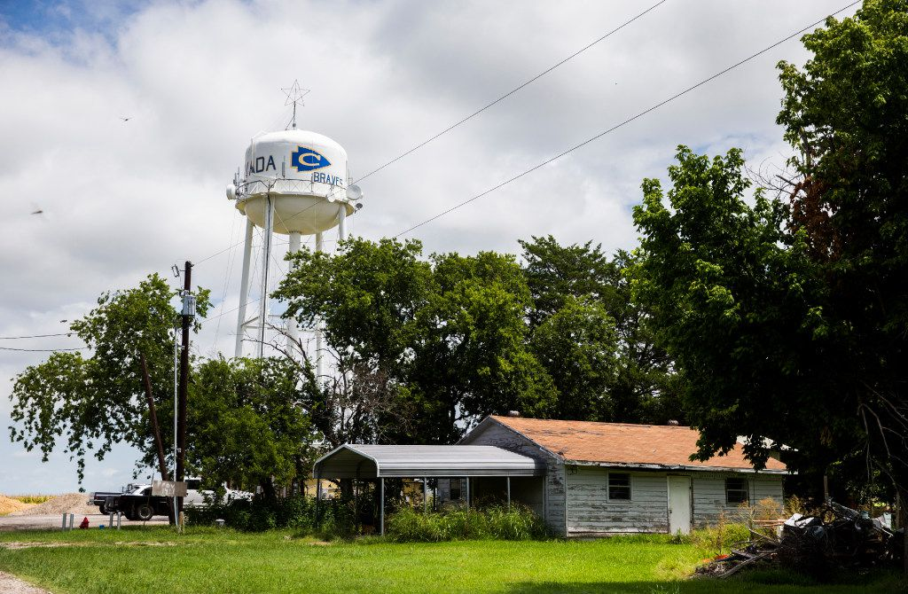 A Nevada water tower stands over a home in Community ISD on Monday, July 24, 2017 in Nevada, Texas. Just like many rural school districts, CISD is struggling to get new teacher applicants.