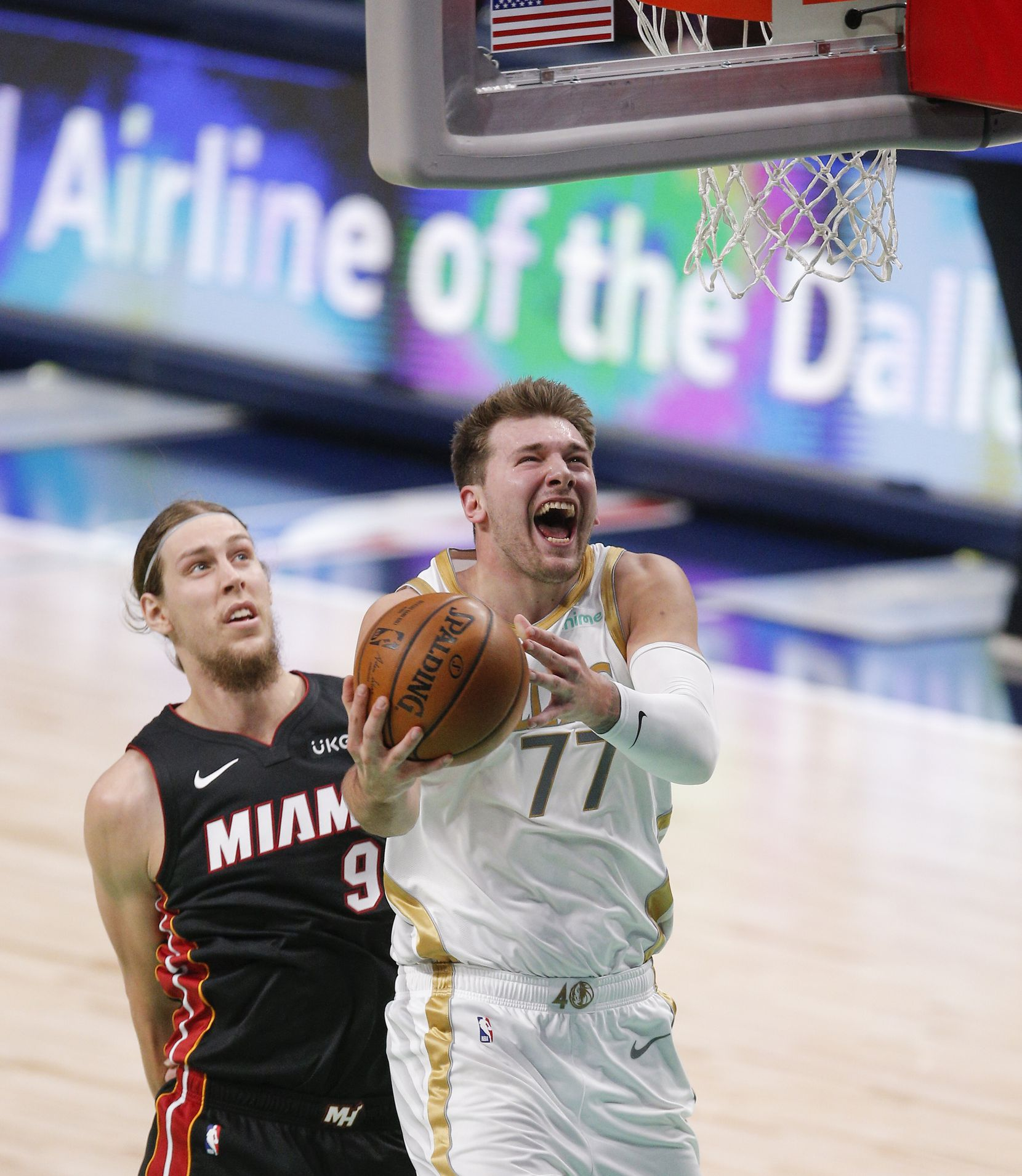 Dallas Mavericks guard Luka Doncic (77) attempts a shot as Miami Heat forward Kelly Olynyk (9) defends during the first half of an NBA basketball game, Friday, January 1, 2021. (Brandon Wade/Special Contributor)
