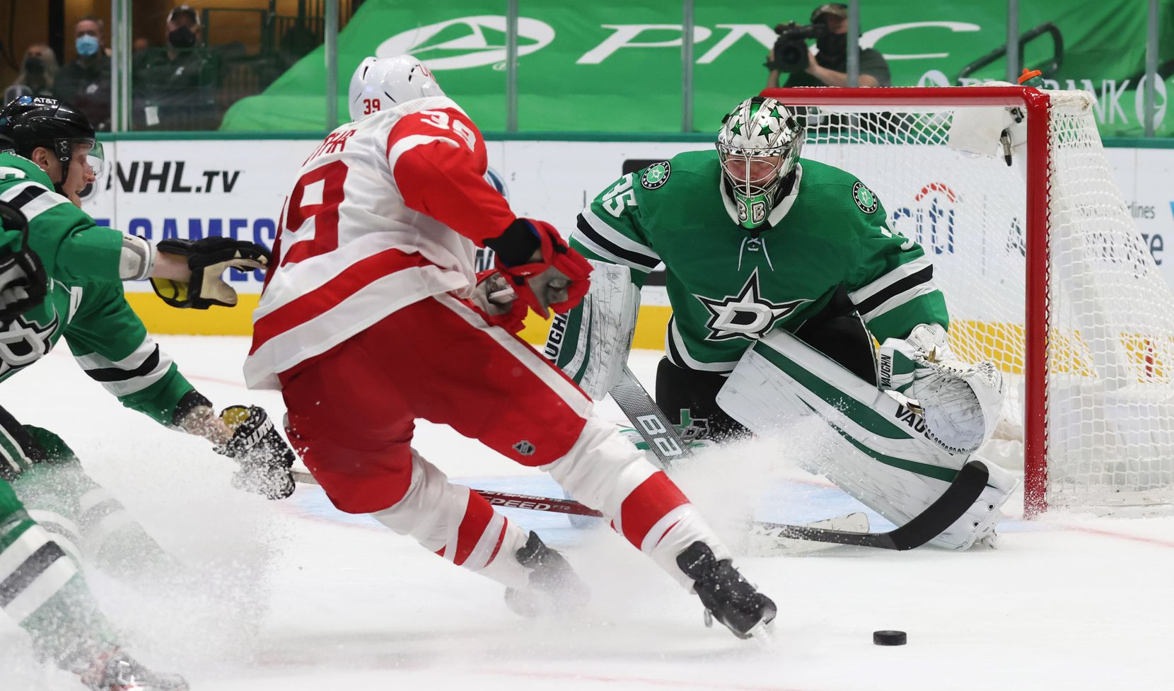Dallas Stars goaltender Anton Khudobin (35) defends the goal as Detroit Red Wings right wing Anthony Mantha (39) advances during the overtime at American Airlines Center on Tuesday, January 26, 2021in Dallas. Dallas Stars defeated the Detroit Red Wings 2-1 in overtime. (Vernon Bryant/The Dallas Morning News)