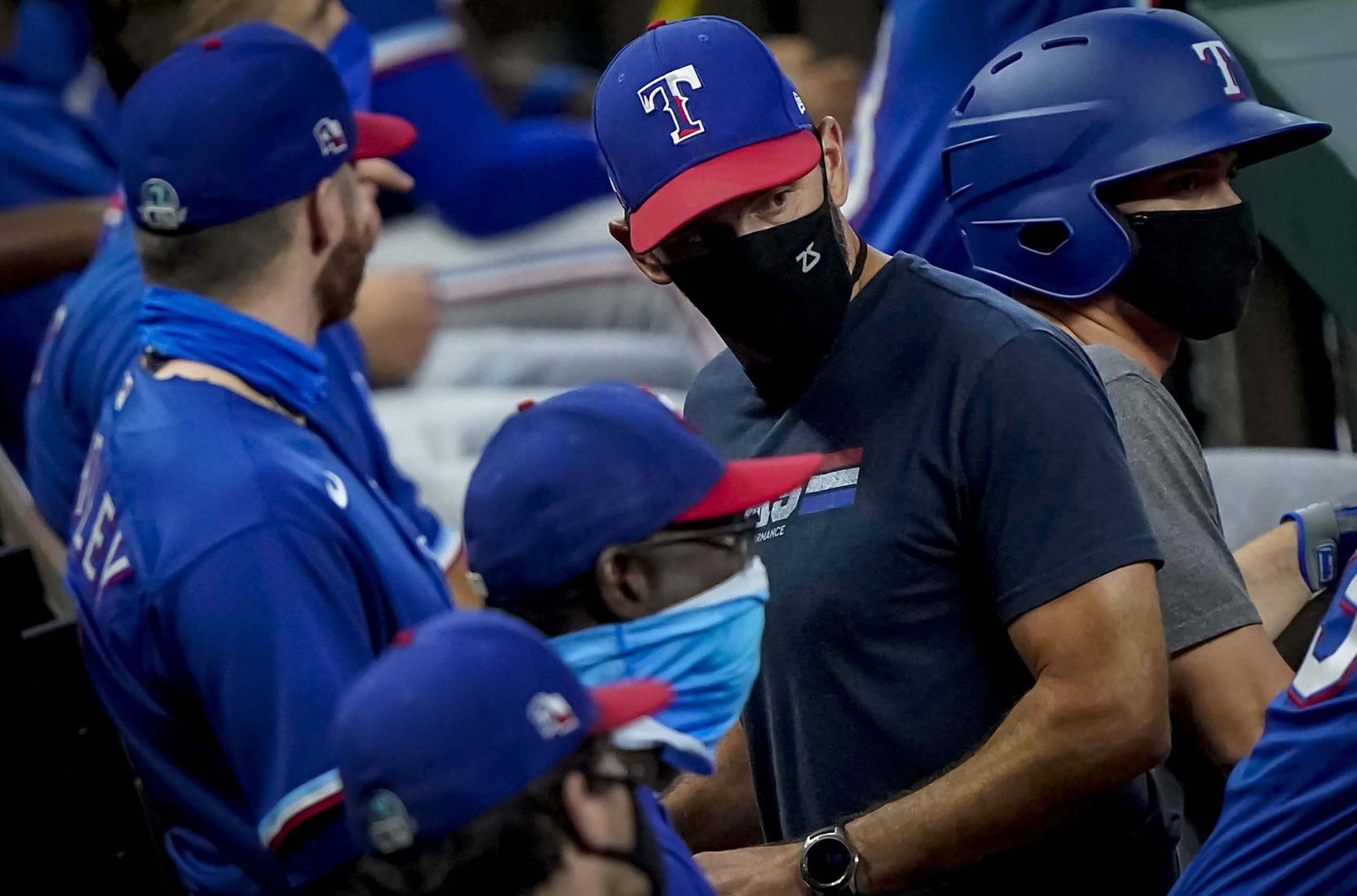 Manager Chris Woodward looks out from the dugout in an intrasquad game during Texas Rangers Summer Camp at Globe Life Field on Saturday, July 18, 2020.