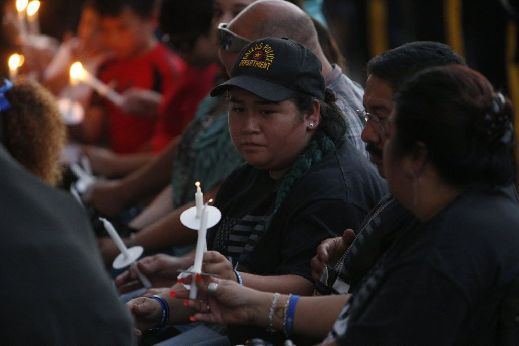 Family members of the police shootings light candels during the candlelight vigil hosted by the Dallas Police Association at Dallas City hall in Dallas, TX July 11, 2016. (Nathan Hunsinger/The Dallas Morning News)
