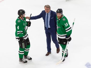 FILE - Miro Heiskanen (4), head coach Rick Bowness and Joe Pavelski (16) of the Stars react to their loss to the Lightning in Game 6 of the Stanley Cup Final at Rogers Place in Edmonton, Alberta, Canada, on Monday, Sept. 28, 2020.