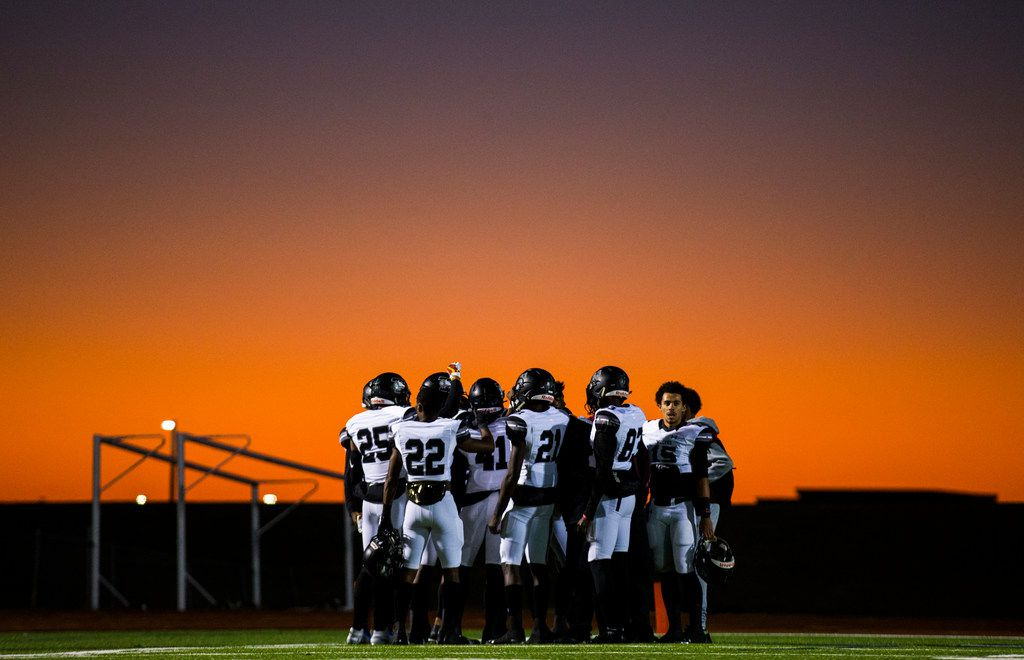 Mansfield Timberview football players gather before a UIL Class 5A Division I first-round playoff football game between Mansfield Timberview and Frisco Independence on Thursday, November 14, 2019 at Frisco ISD Memorial Stadium in Frisco. (Ashley Landis/The Dallas Morning News)