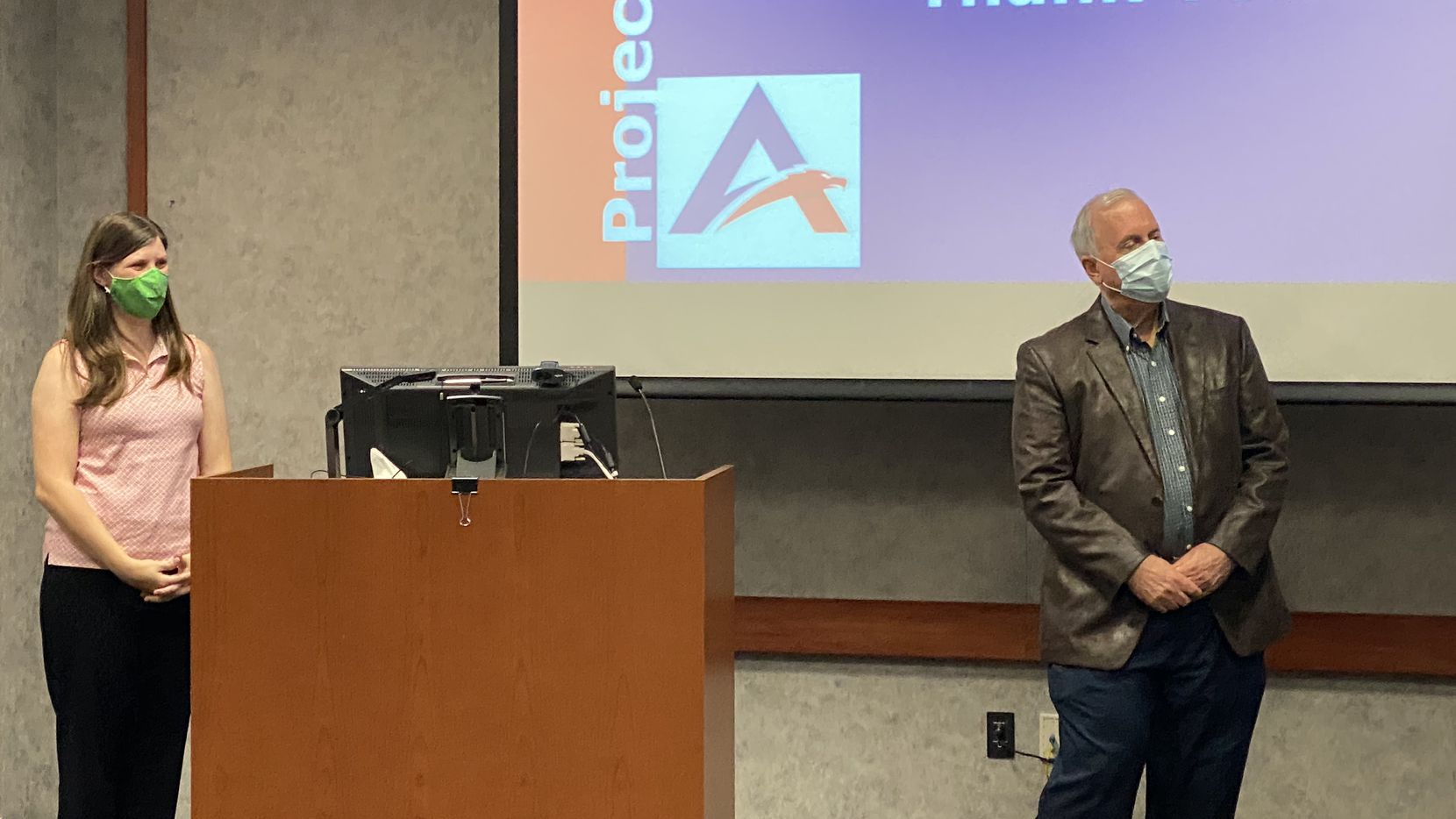 Theresa Ginsburg and Bob Acker, members of a committee designed to make a bond recommendation to the school board, presented to the Allen ISD Board of Trustees at a July 20 workshop.