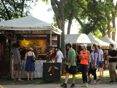 Patrons walk the festival looking at art at Cottonwood Arts Festival in Richardson in 2016. The festival was among three that were recently canceled by the city due to ongoing coronavirus concerns.