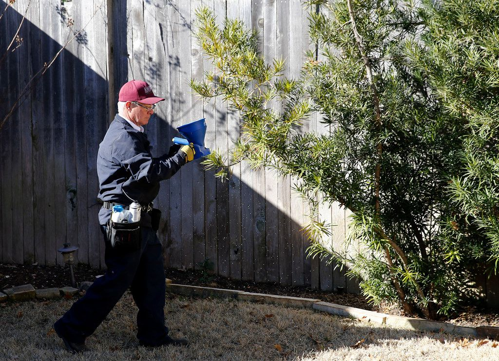 Steve Florsheim of ABC Home and Commercial Services works on preventative pest treatment at a home in Dallas.