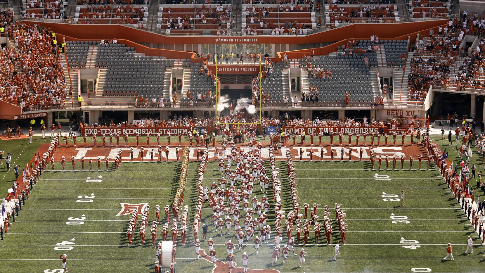 The Texas Longhorns football team sprints down the middle of the field as they introduced to the DKR-Texas Memorial Stadium crowd in Austin, Saturday, September 4, 2021.