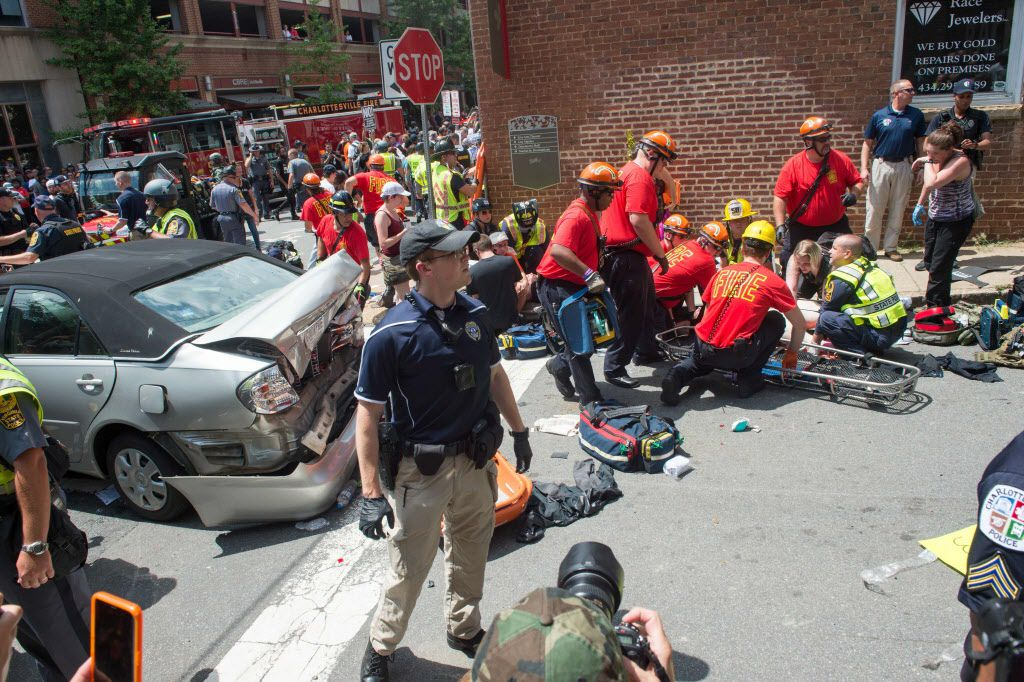 A woman is received first-aid after a car accident ran into a crowd of protesters in Charlottesville, VA on August 12, 2017.  A picturesque Virginia city braced Saturday for a flood of white nationalist demonstrators as well as counter-protesters, declaring a local emergency as law enforcement attempted to quell early violent clashes.  / AFP PHOTO / PAUL J. RICHARDSPAUL J. RICHARDS/AFP/Getty Images