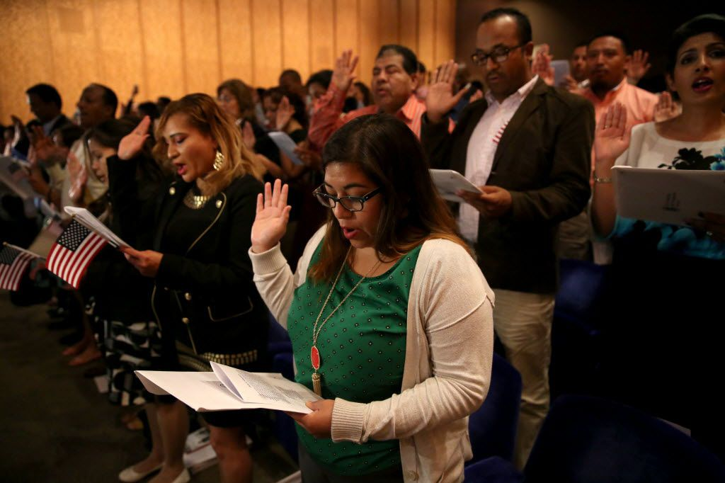 Adriana Sellers from Argentina takes the Oath of Allegiance to become a U.S. citizen during the naturalization ceremony hosted by the Dallas Museum of Art at the museum in Dallas on Monday, May 23, 2016. (Rose Baca/The Dallas Morning News)