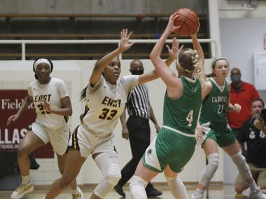 Southlake Carroll's Brittney Flexer (4) looks to pass as she is defended by Plano East's Tiana Amos (33) during the first half of Plano East's 56-42 victory in a Class 6A Region I semifinal Saturday. (Steve Hamm/Special Contributor)