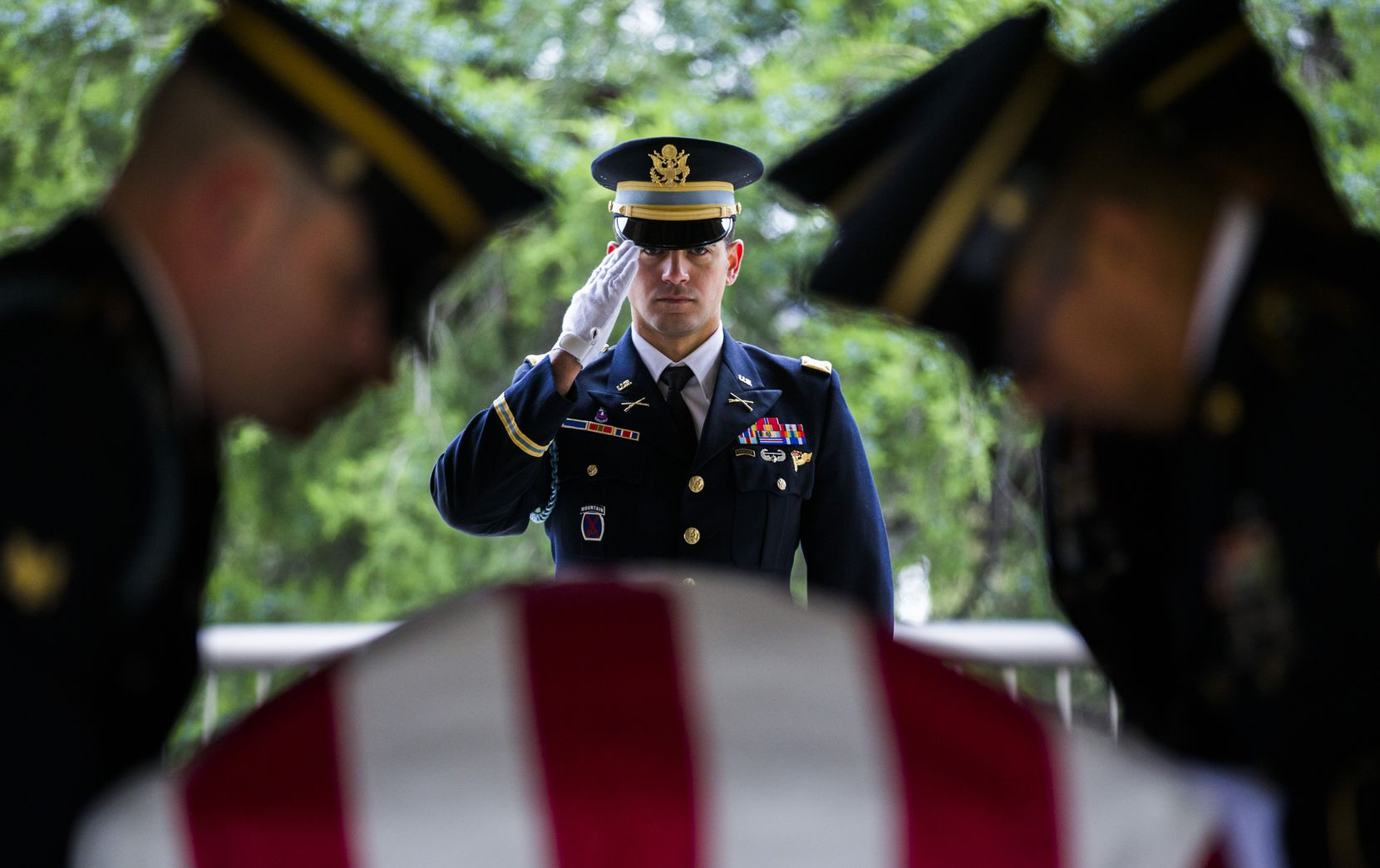 """Members of the Army Honor Guard carry a casket containing the remains of Army Corporal Albert """"Buddy"""" Mills at Dallas-Fort Worth National Cemetery on November 12, 2018 in Dallas. Mills went missing and was killed in action during the Korean War. In July, his remains were found and identified. After nearly seven decades, Albert """"Buddy"""" Mills is finally back home. Since 1950, the fate of the Dallas native had remained a mystery to his family, who knew only that he had been listed as missing and likely killed in action during the Korean War. Then, in July, one of Mills' seven surviving nieces and nephews got a surprising call: An unidentified soldier's remains, tested at another family's request, had turned out to be those of Mills, finally giving his family the closure they thought they'd never find."""
