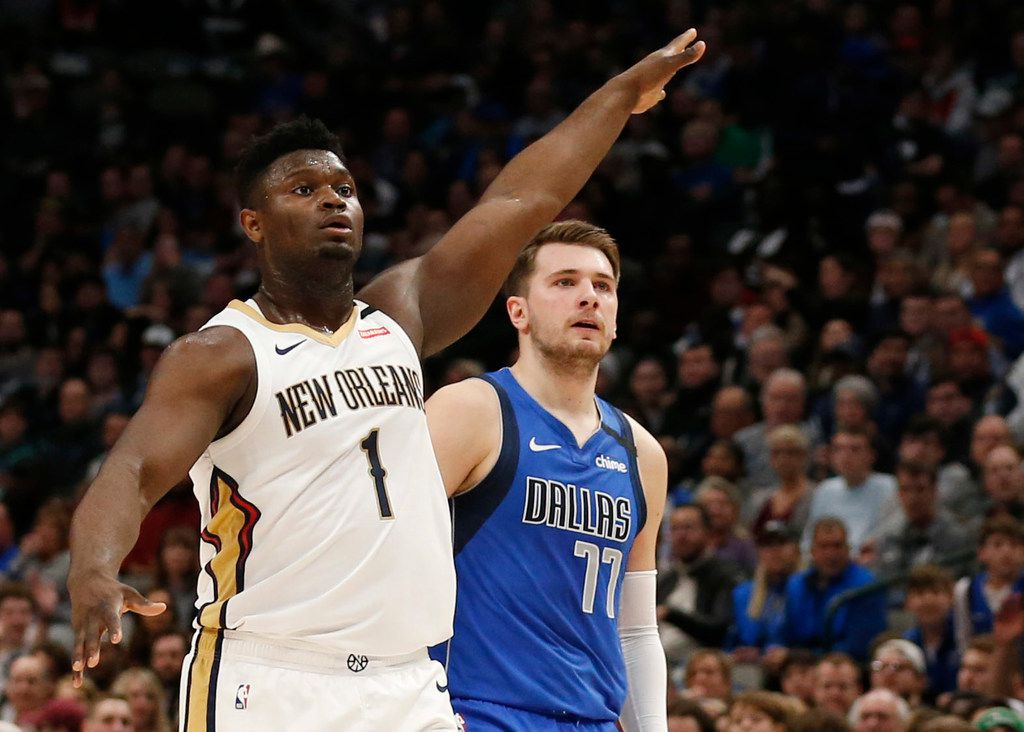 Dallas Mavericks guard Luka Doncic (77) watches his made shot after shooting over New Orleans Pelicans forward Zion Williamson (1) during the first quarter of play at American Airlines Center in Dallas on Wednesday, March 4, 2020.