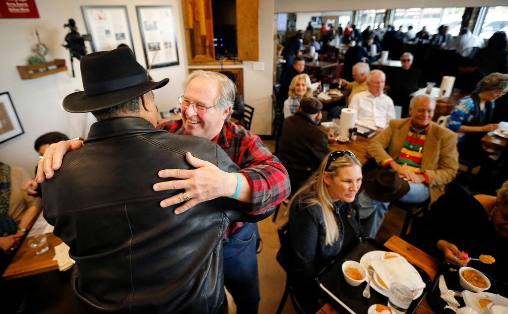 "John ""Smokey"" Reaves (left) gets a hug from Jack McNairy after he kicked off the weekly Bible study session at the restaurant that bears his name."