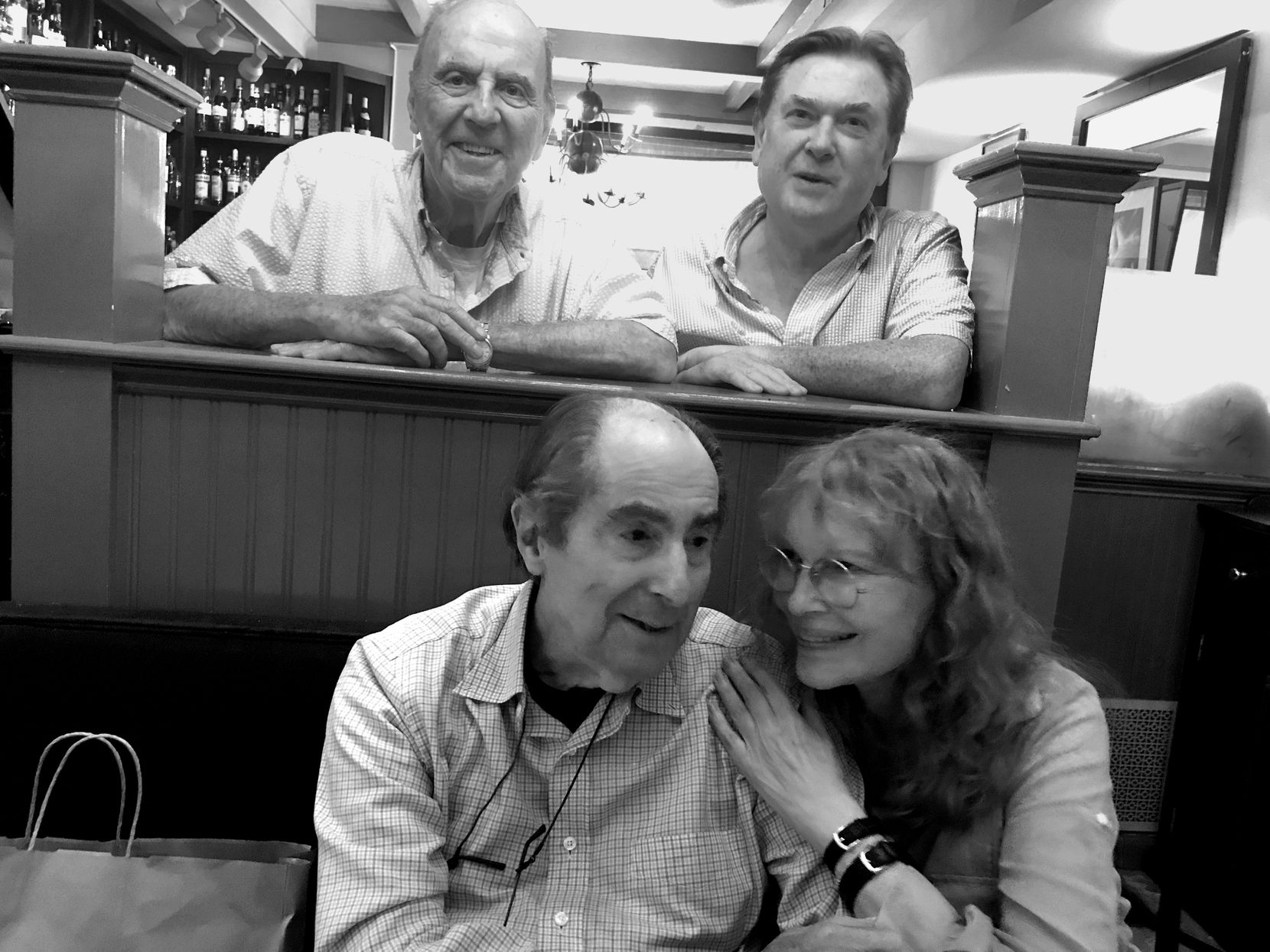 In Philip Roth's final years, he often met his close friend Mia Farrow at his favorite Connecticut restaurant, the West Street Grill in Litchfield. The owners, Charlie Kafferman and James O Shea (standing in back), were old friends. (Courtesy of Mia Farrow)