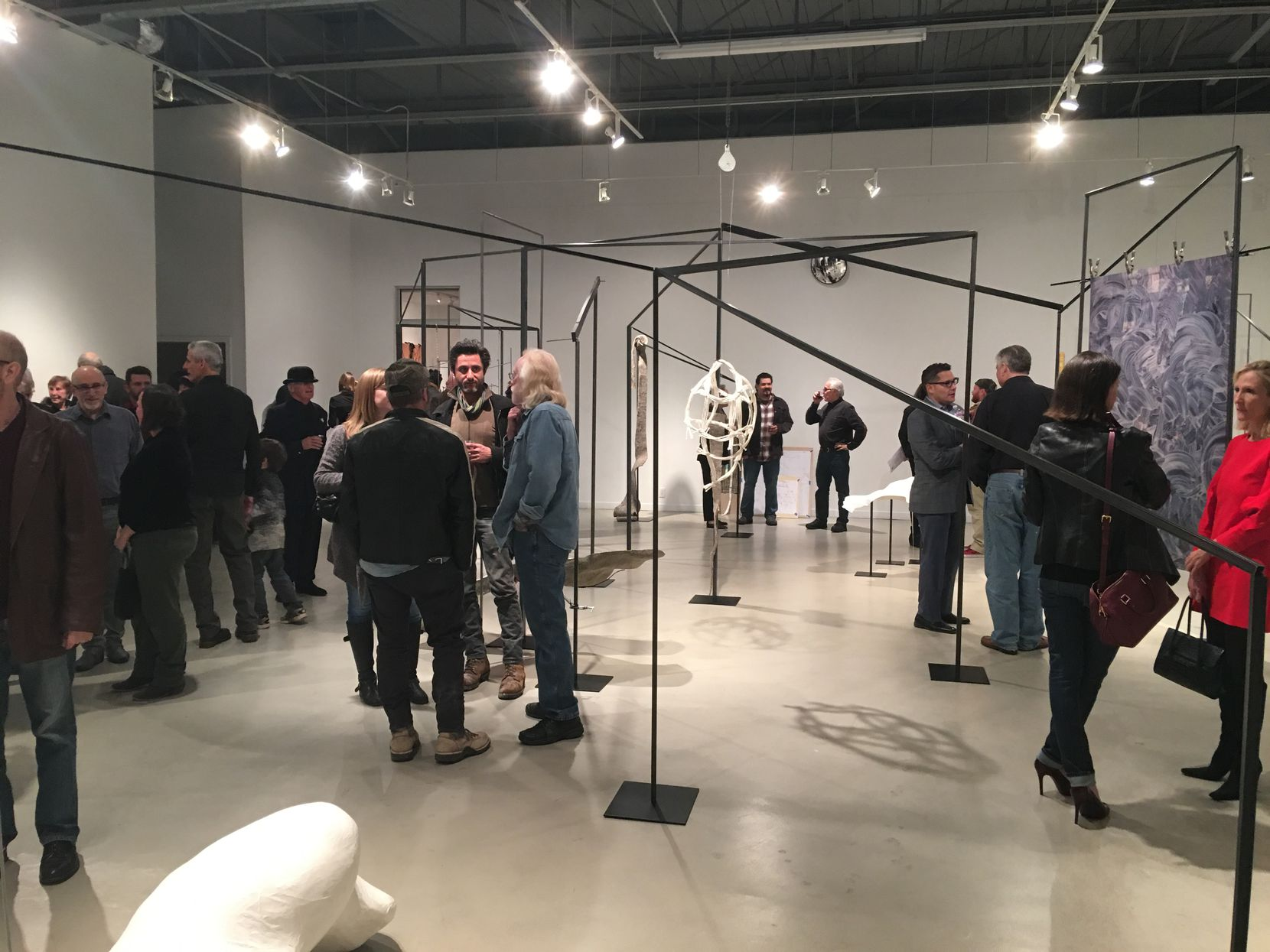"""Opening night of France Bagley's """"The Lay of the Land"""" at Kirk Hopper gallery. (Rick Brettell/The Dallas Morning News)"""