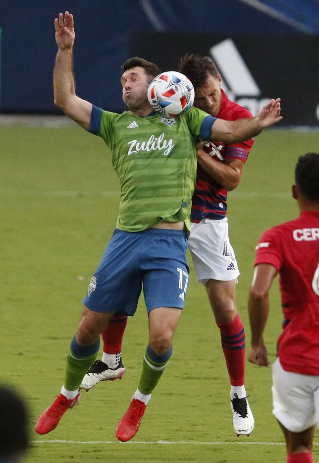 FC Dallas defender Bressan (4) and Seattle Sounders defender Will Bruin (17) battle for a header during the first half as FC Dallas hosted the Seattle Sounders at Toyota Stadium in Frisco on Wednesday night, August 18, 2021. (Stewart F. House/Special Contributor)