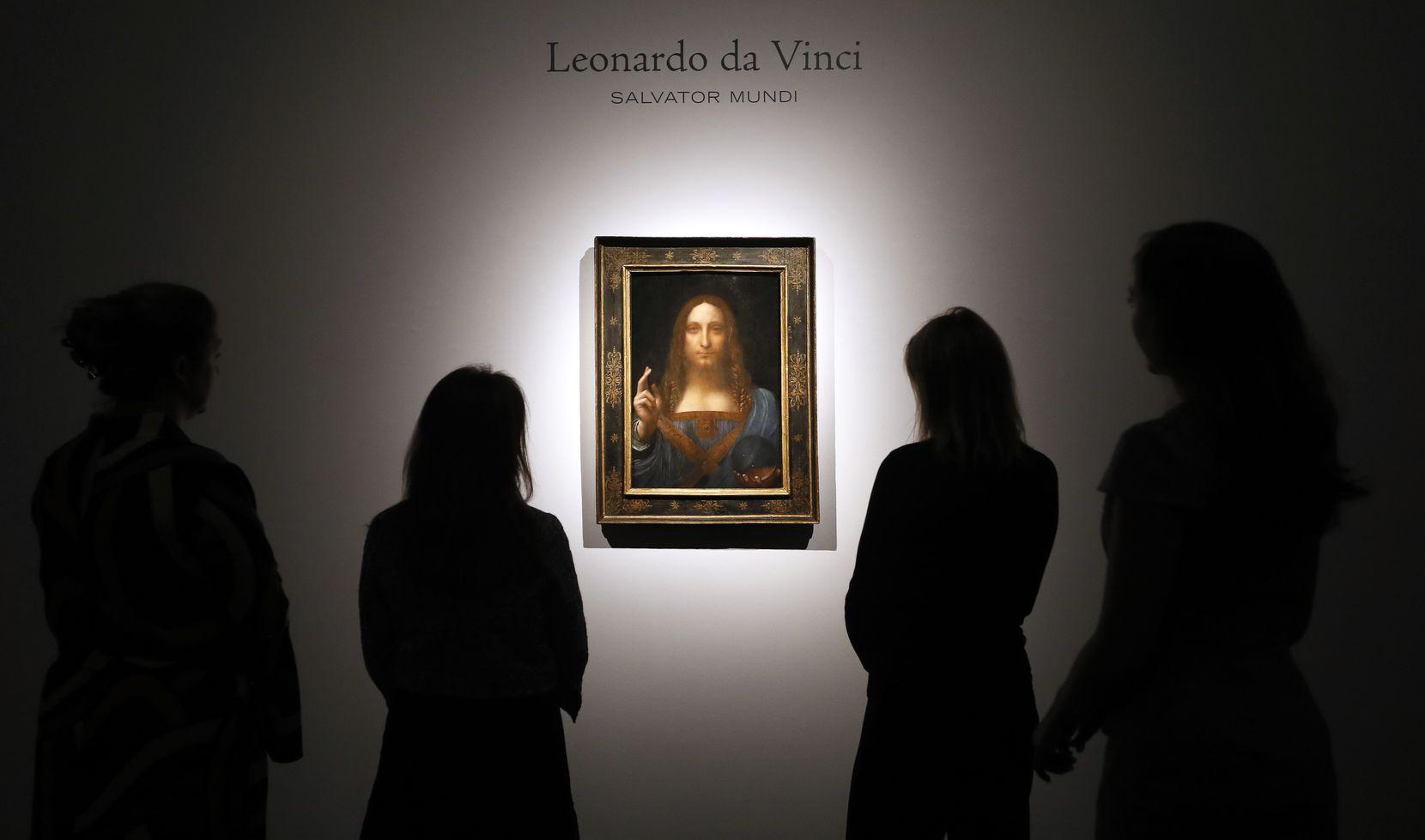 "People gathered around Leonardo da Vinci's ""Salvator Mundi"" at a Christie's auction room in London in October 2017."