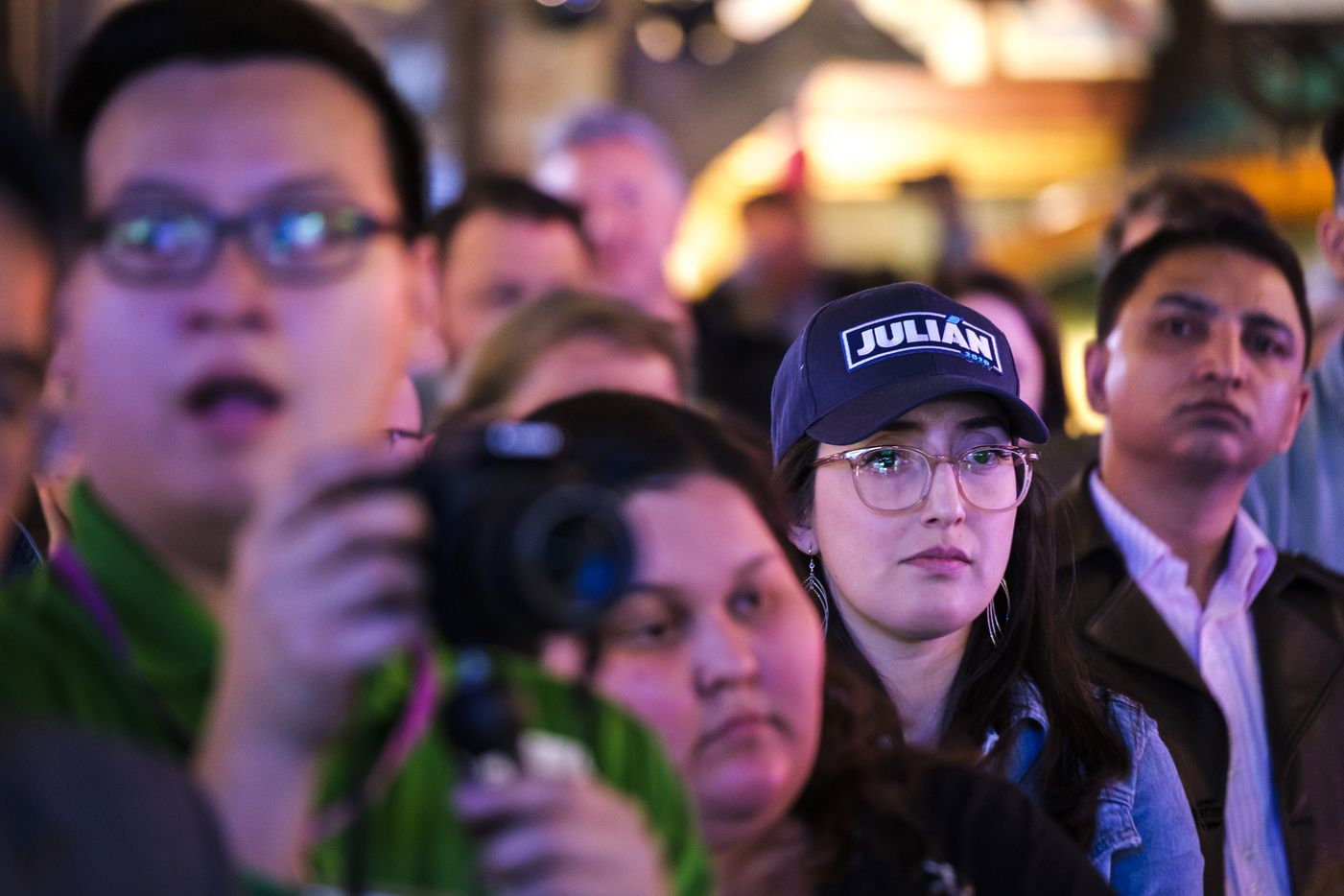 Supporters listen as Presidential candidate Julian Castro speaks during a campaign event at St. Pete's Dancing Marlin in on Tuesday, March 19, 2019.