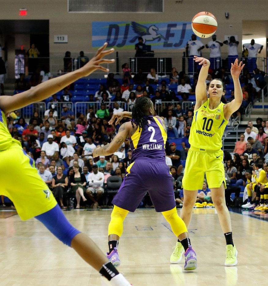 Dallas Wings guard Leticia Romero (10) passes to a teammate over the defense of LA Sparks guard Riquna Williams (2) during second half action. The two teams played their WNBA game at UT-Arlington's College Park Center in Arlington on June 22, 2018. (Steve Hamm/ Special Contributor)