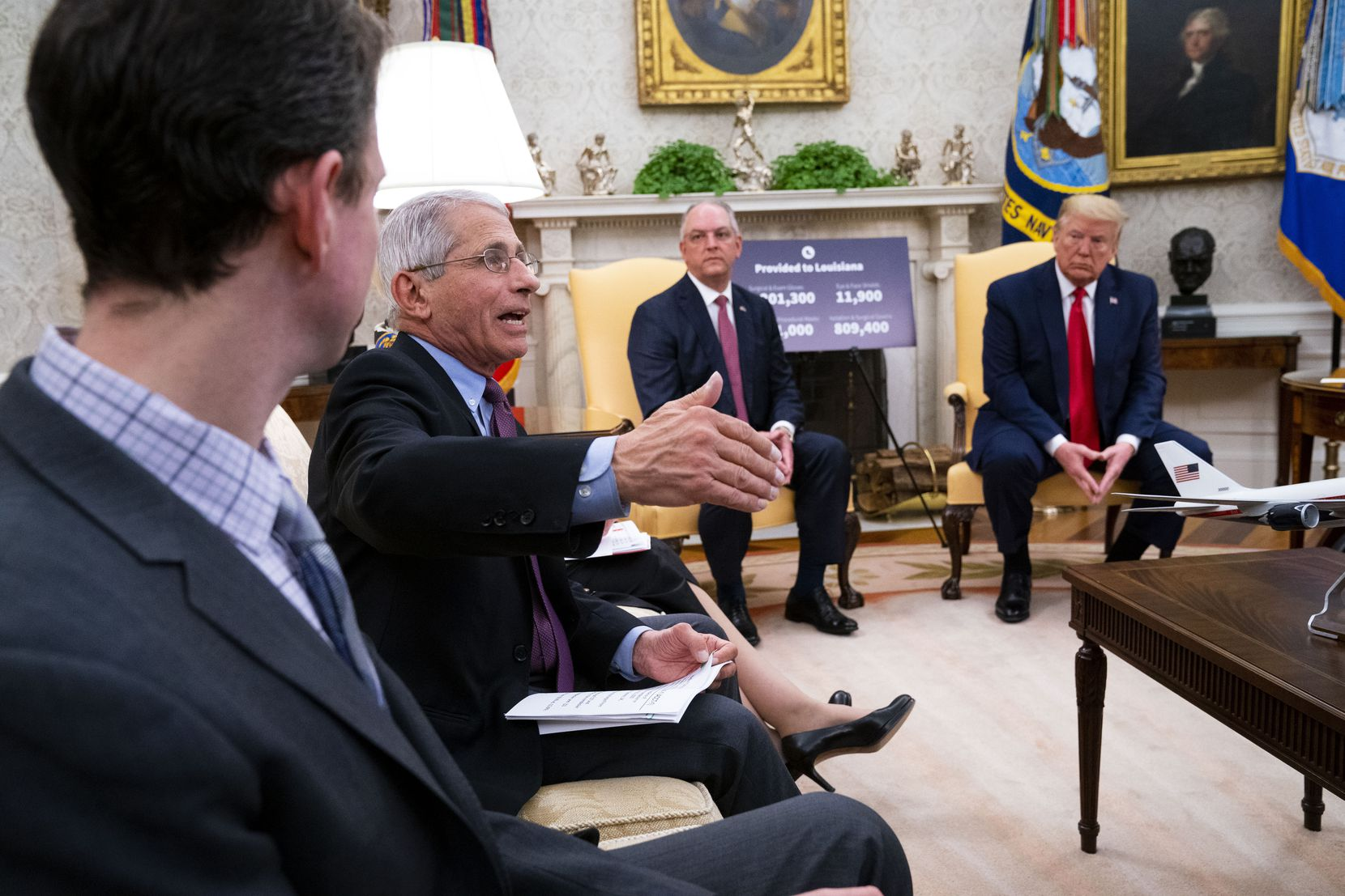 """WASHINGTON, DC - APRIL 29:  Dr. Anthony Fauci (2nd L), Director of the National Institute of Allergy and Infectious Diseases, discusses early results of testing the drug Remdesivir during a meeting with U.S. President Donald Trump and Louisiana Gov. John Bel Edwards (2nd R) in the Oval Office of the White House April 29, 2020 in Washington, DC. Fauci said the early testing results were """"quite good news""""."""