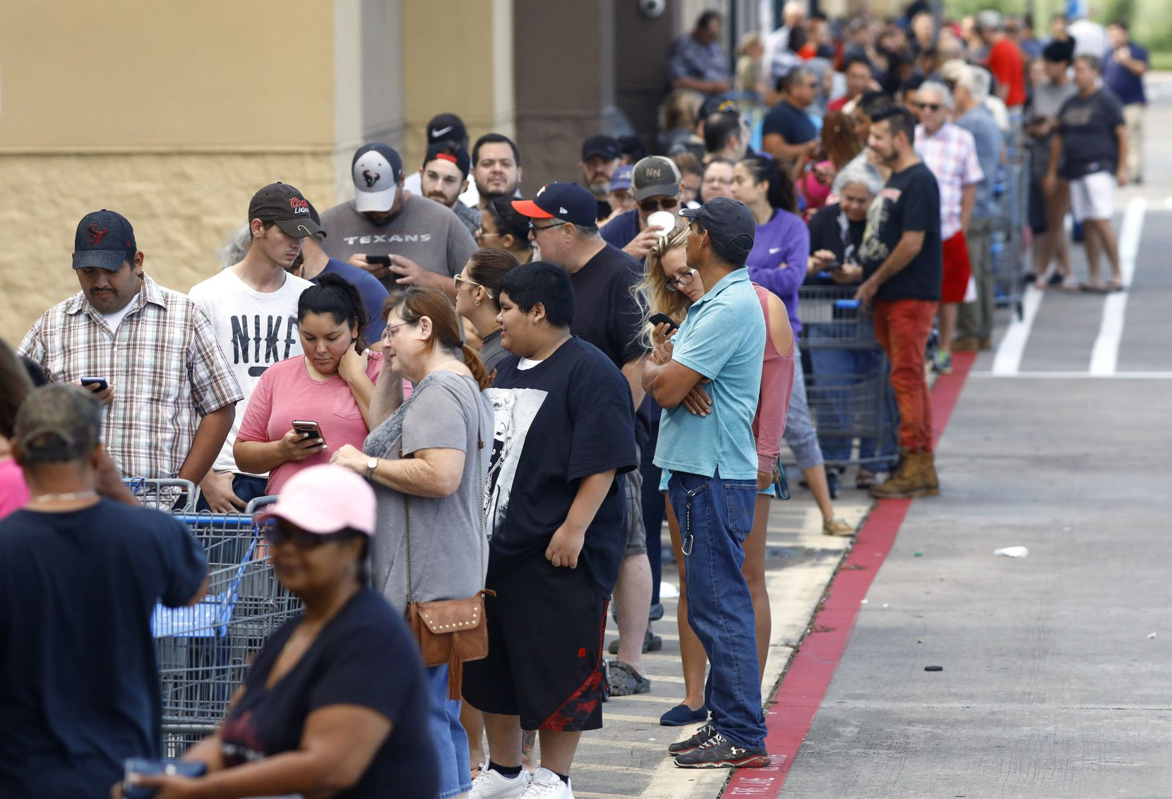 A long line stretched across the front of the Walmart on Hwy. 35 in Pearland, Texas, Wednesday, August 30, 2017, as they opened for the first time since Hurricane Harvey. Hundreds of people showed up to get groceries and supplies.