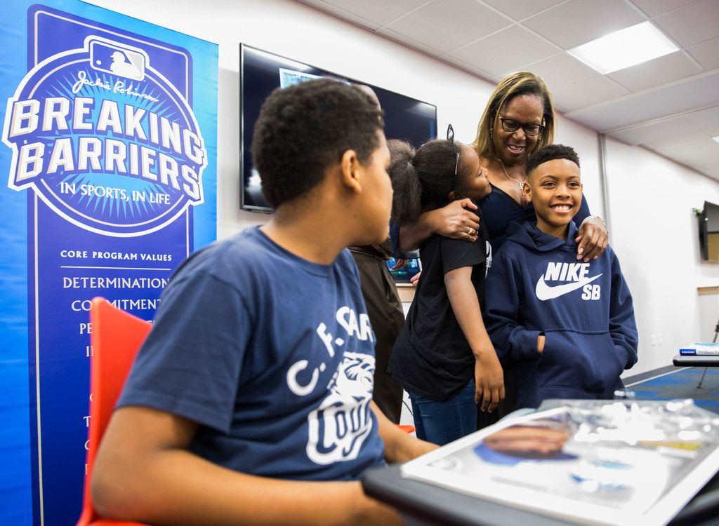 Sharon Robinson, daughter of baseball Hall of Famer Jackie Robinson, hugged students from the Texas Rangers MLB Youth Academy during a visit last year to the Mercy Street Sports Complex in Dallas. Sharon Robinson is an educational consultant for Major League Baseball, vice chairwoman of the Jackie Robinson Foundation and the author of several books for young readers.