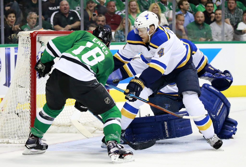 Dallas Stars right wing Patrick Eaves (18) attempts a shot on St. Louis Blues goalie Brian Elliott (1) as defenseman Carl Gunnarsson (4) closes in during the first period in Game 1 of the Western Conference Semifinals at the American Airlines Center in Dallas, Friday, April 29, 2016.  (Tom Fox/The Dallas Morning News)