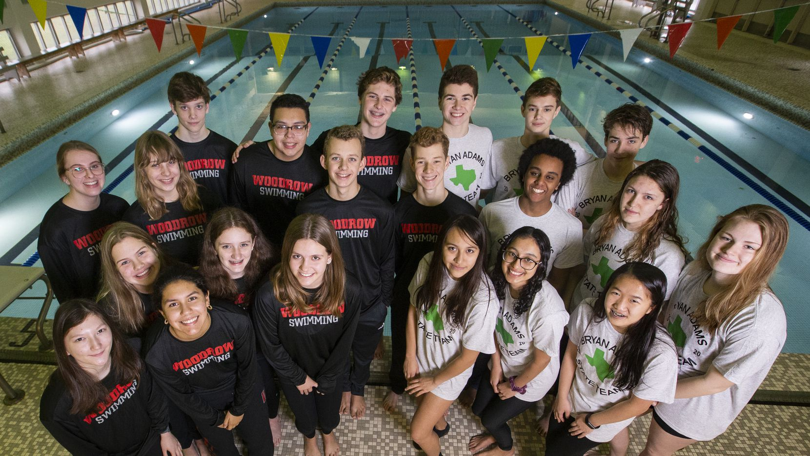 Swimmers from Woodrow Wilson and Bryan Adams High School who qualified for this weekend's UIL swimming and diving state meet pose for a photo at Alamo Swimming Pool on Feb. 13, 2020 in Dallas.