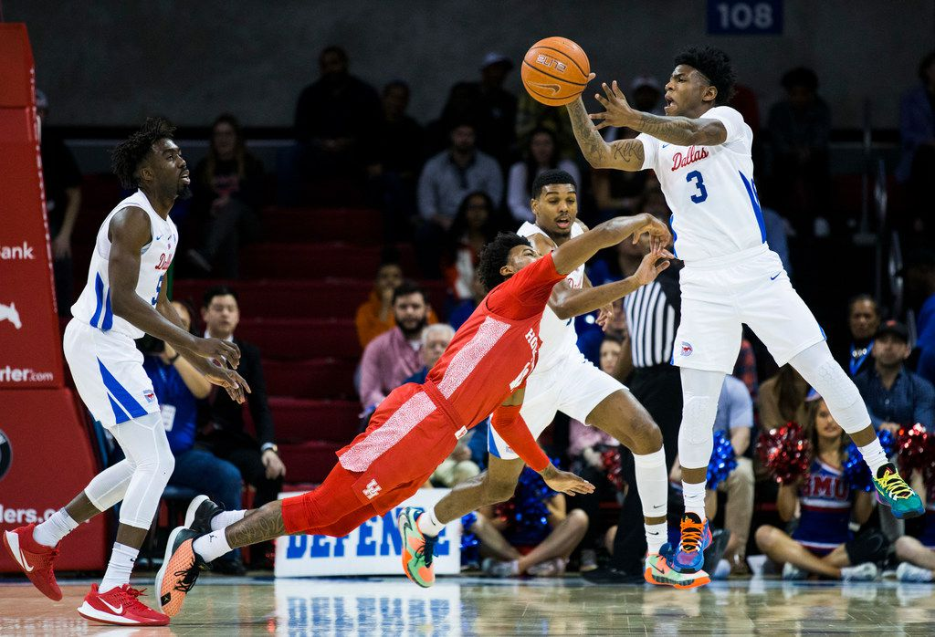 FILE - SMU guard Kendric Davis (3) reaches for a loose ball over Houston guard Nate Hinton (11) during the first half of a game on Saturday, Feb. 15, 2020, at Moody Coliseum in Dallas.