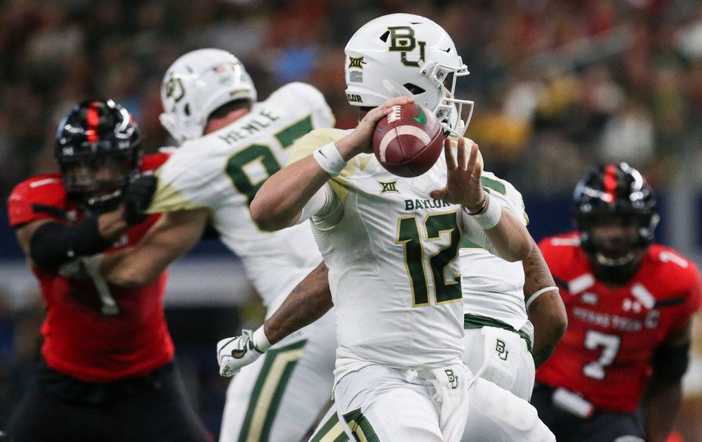 Baylor Bears quarterback Charlie Brewer (12) fires off a pass during the second half of a matchup between Baylor and Texas Tech on Saturday, Nov. 24, 2018 at AT&T Stadium in Arlington, Texas. (Ryan Michalesko/The Dallas Morning News)