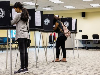 Zuleima Martinez, left, and Sananda McCall, both of Arlington, Texas cast their vote on Election Day at Tarrant County Sub-Courthouse in Arlington on Nov. 6, 2018.
