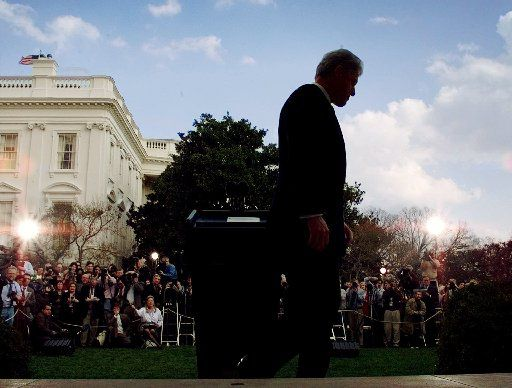 President Bill Clinton walks away from the podium after making a statement in the Rose Garden at the White House Friday, Feb. 12, 1999. Thirteen months after the Monica Lewinsky affair rattled the White House, the Senate acquitted Clinton in the Senate impeachment trial and put to end the second presidential impeachment trial in U.S. history.