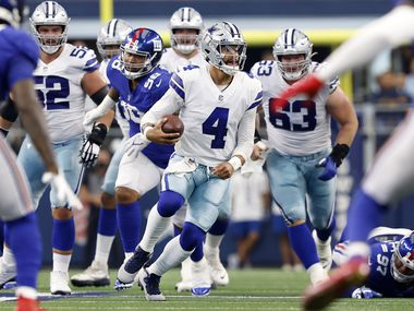 Dallas Cowboys quarterback Dak Prescott (4) races through a big hole in the line in the first quarter against the New York Giants at AT&T Stadium in Arlington, Texas, Sunday, October 10, 2021.