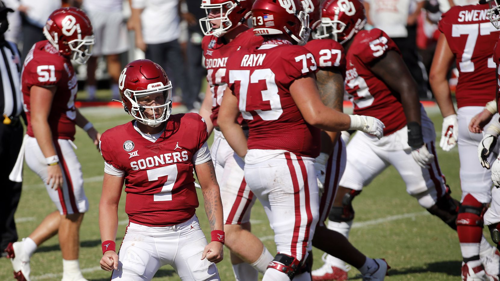 Oklahoma Sooners quarterback Spencer Rattler (7) gives a look to the student sedition after scoring a touchdown in the second overtime against the Texas Longhorns in the Red River Rivalry at the Cotton Bowl in Dallas, Saturday, October 10, 2020. Oklahoma won in quadruple overtime, 53-45.