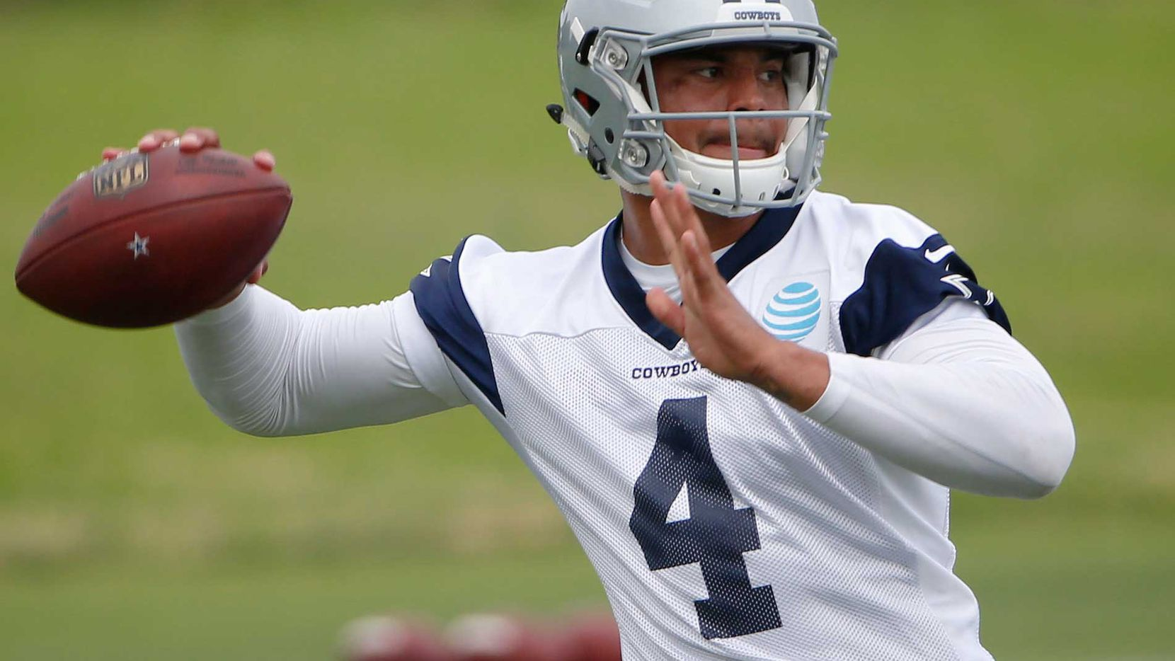 Dallas Cowboys quarterback Dak Prescott (4) throws the ball during organized team activities at Cowboys headquarters in Irving, Texas Wednesday May 25, 2016. (Andy Jacobsohn/The Dallas Morning News)