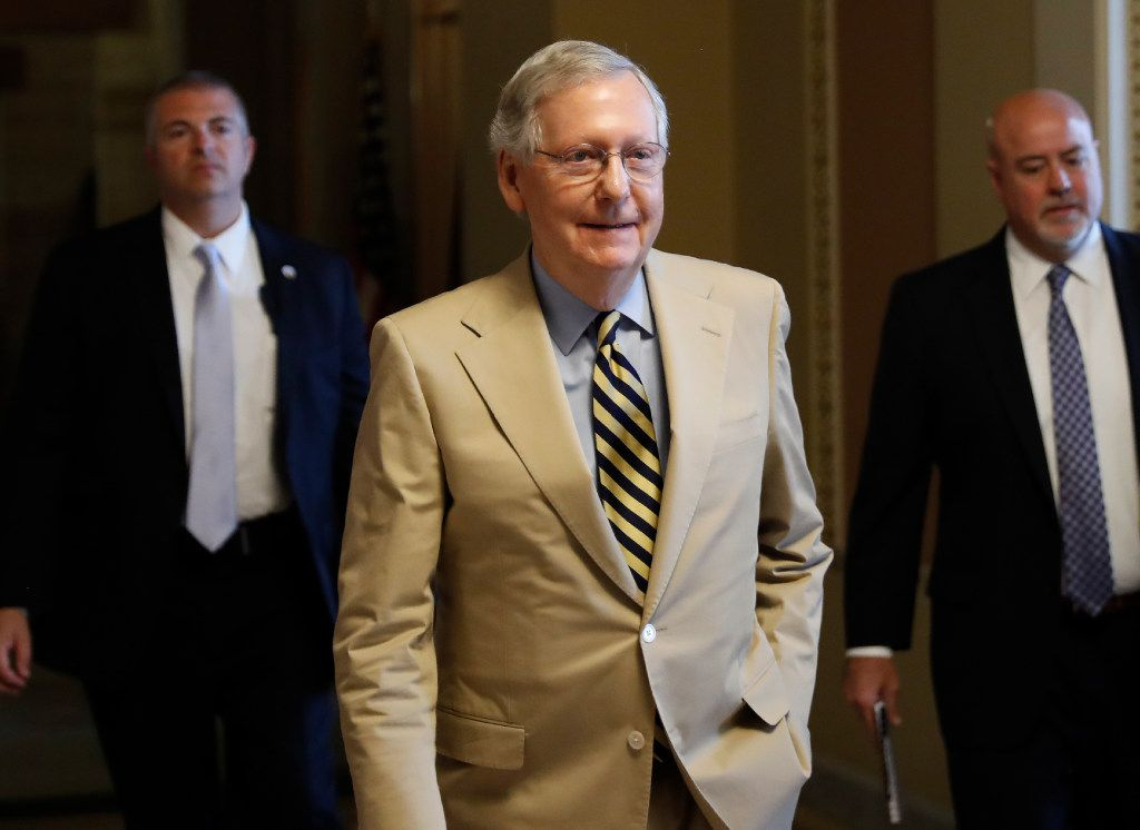 """Senate Majority Leader Mitch McConnell of Ky. walks from his office on Capitol Hill in Washington, Monday, June 26, 2017. Senate Republicans unveil a revised health care bill in hopes of securing support from wavering GOP lawmakers, including one who calls the drive to whip his party's bill through the Senate this week """"a little offensive."""" (AP Photo/Carolyn Kaster)"""