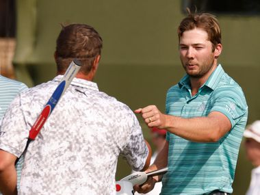 Sam Burns and Bryson DeChambeau bump fists after completing round 2 of the AT&T Byron Nelson  at TPC Craig Ranch on Friday, May 14, 2021 in McKinney, Texas.