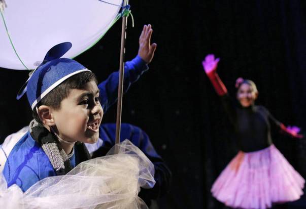 Anthony Bedolla, 7, and Sorany Gutiérrez share the stage in The Circus That Came From Mars.