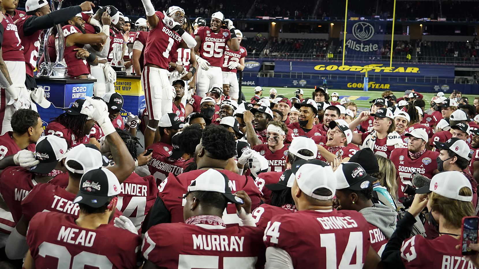 Oklahoma players celebrate after beating Florida in the Cotton Bowl Classic at AT&T Stadium on Wednesday, Dec. 30, 2020, in Arlington.