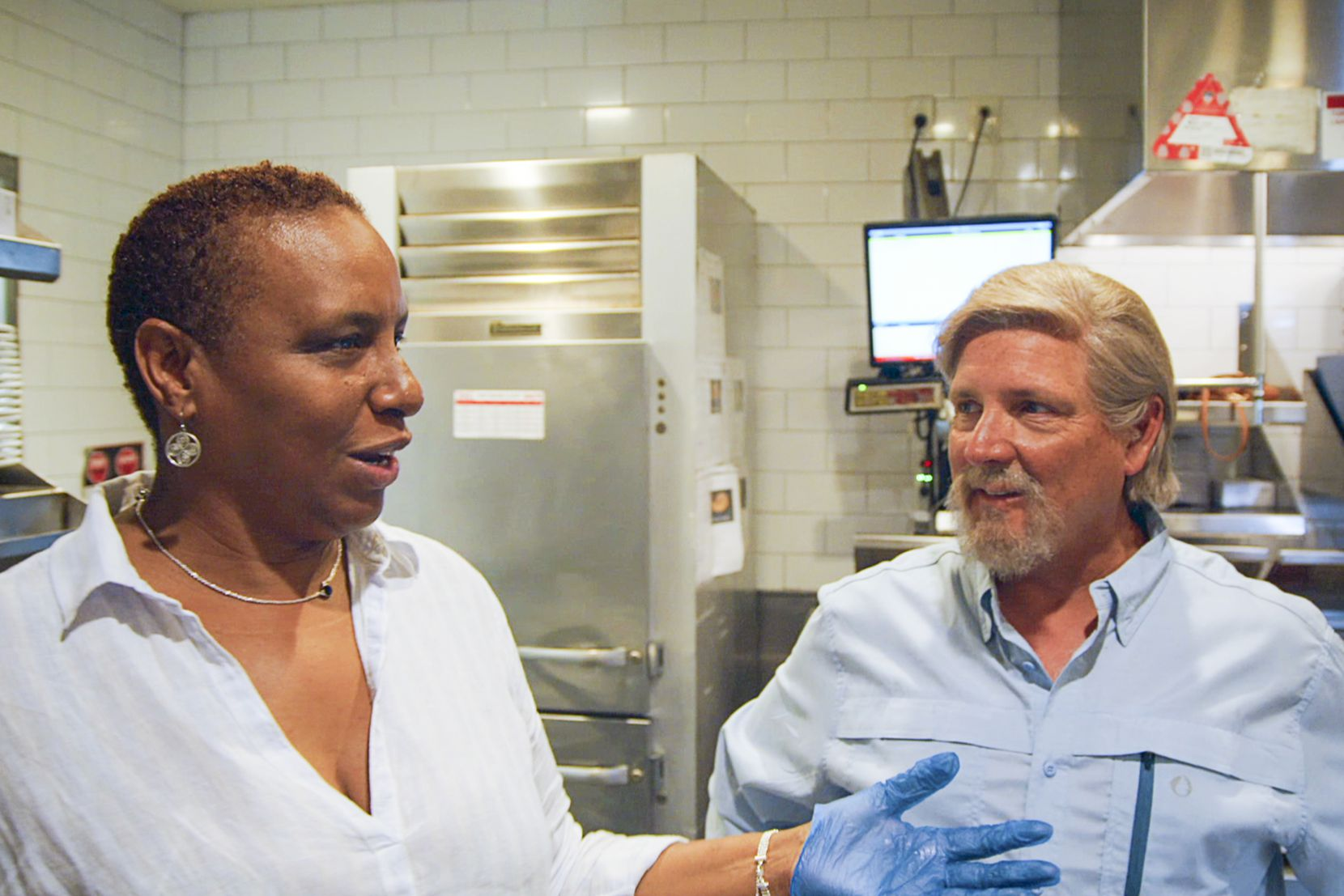 TGI Fridays CEO Ray Blanchette (right) was filmed for the CBS show 'Undercover Boss' in Fall 2019. During the filming, Blanchette talked with an assistant manager who doesn't realize she's having a conversation with the CEO.