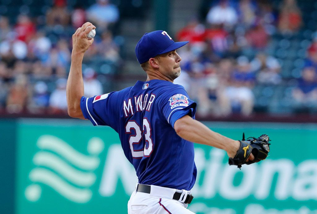 Texas Rangers starting pitcher Mike Minor (23) throws to the Los Angeles Angels in the first inning of a baseball game in Arlington, Texas, Tuesday, July 2, 2019. (AP Photo/Tony Gutierrez)