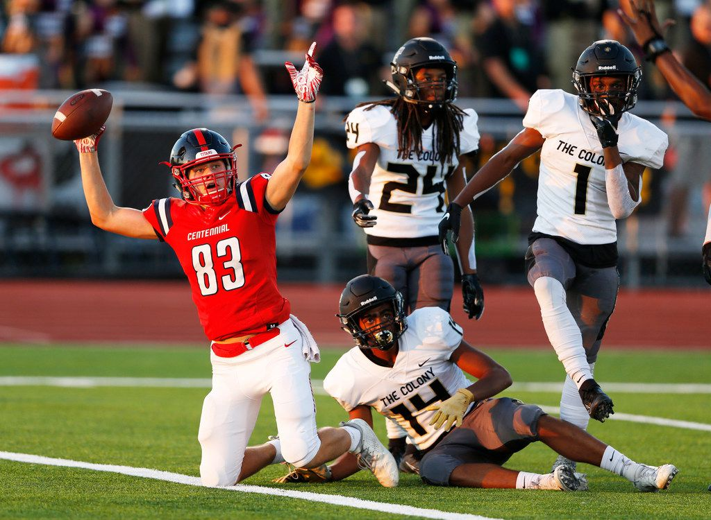 Centennial's Jacob McCoy (83) signals a touchdown after scoring a touchdown as The Colony's Stephen Wallak (14), Myles Price (1) and Shafiq Taylor (24) watch for the signal during the first half of play at Memorial Stadium in Frisco, Texas on Thursday, September 26, 2019. (Vernon Bryant/The Dallas Morning News)