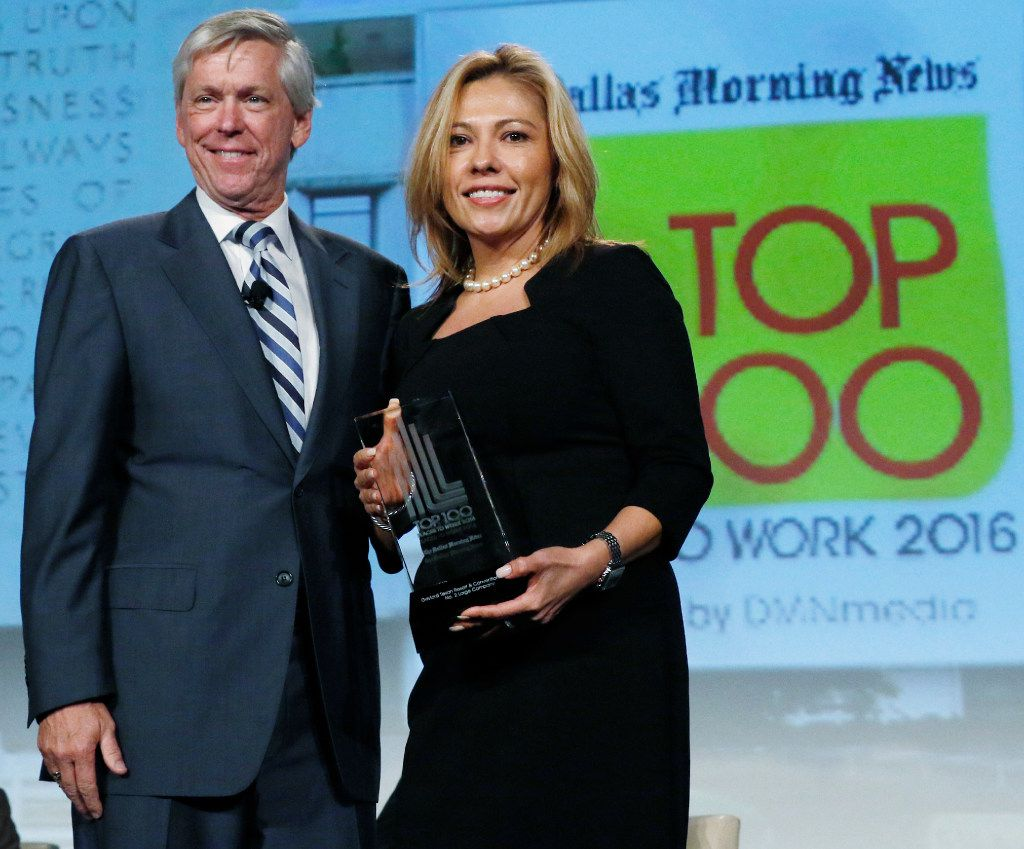 Jim Moroney, Publisher and CEO of the Dallas Morning News, left, with Gracie Vega, director of human resources at Gaylord Texan Resort & Convention Center after accepting for the award best No. 2 large company at the Top 100 Place to Work luncheon at the Dallas Omni Hotel on Friday, November 17, 2016 in Dallas, Texas. (David Woo/The Dallas Morning News)