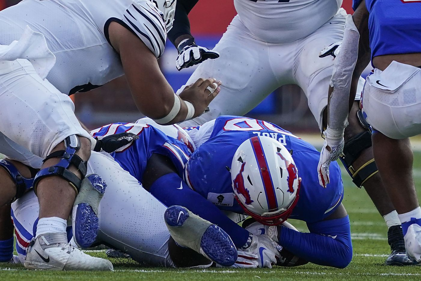 SMU defensive end Nelson Paul (90) reaches for a Memphis fumble that was recovered by the Mustangs with just over a minute left to play, setting up a game-winning field goal during the second half of an NCAA football game at Ford Stadium on Saturday, Oct. 3, 2020, in Dallas.